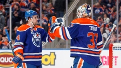 Kris Russell & Cam Talbot celebrate
