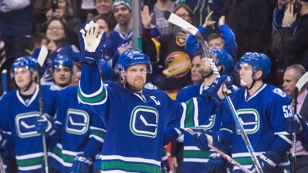 Henrik-sedin-celebrates-1-000th-point