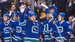 Henrik Sedin celebrates 1,000th point