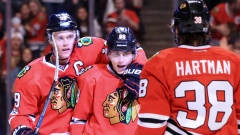 Jonathan Toews, Patrick Kane and Ryan Hartman