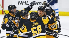 Penguins celebrate with Crosby