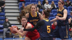 Stephanie Carr surrounded by Queen's Gaels' players