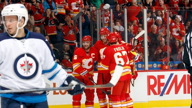 Mark Giordano, Dougie Hamilton and Flames celebrate