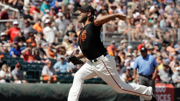 Giants' Bumgarner becomes 1st pitcher to hit 2 opening day home runs