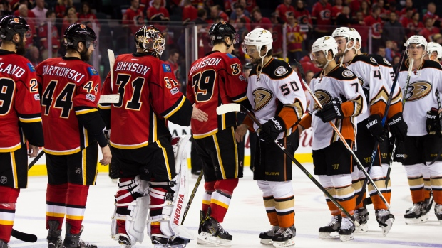 Anaheim Ducks and Calgary Flames shake hands