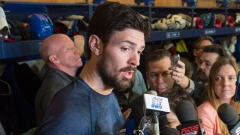 Carey Price talks to reporters