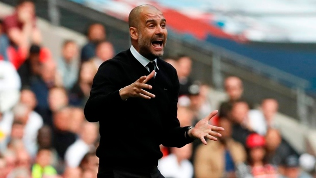 Guardiola: Man City to rein in spending after record outlay