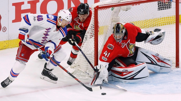 Michael Grabner and Craig Anderson