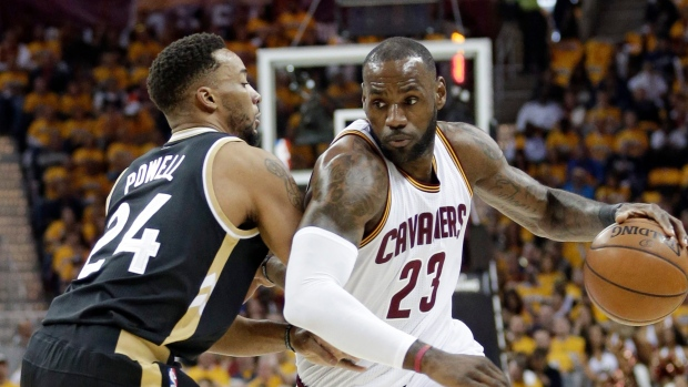 e3b800481 James scores 39 as Cavaliers rout Raptors. The Canadian Press. LeBron James  and Norman Powell. LeBron James and Norman Powell