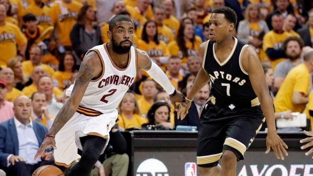 Kyle Lowry guards Kyrie Irving