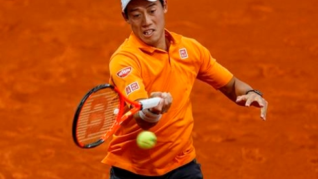 Nishikori beats Ferrer to set up Djokovic showdown in Madrid