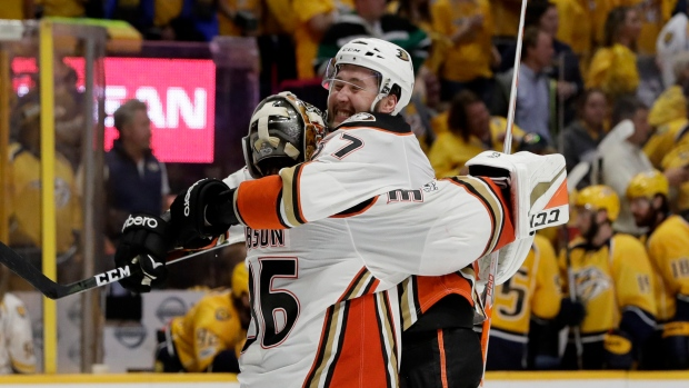 John Gibson and Andrew Cogliano celebrate victory
