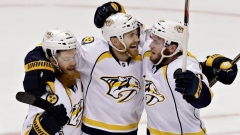 Colin Wilson, centre, celebrates with Ryan Ellis, left, and Colton Sissons