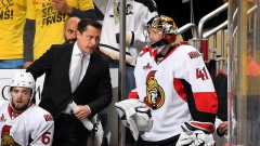 Guy Boucher talks to Craig Anderson during Game 5