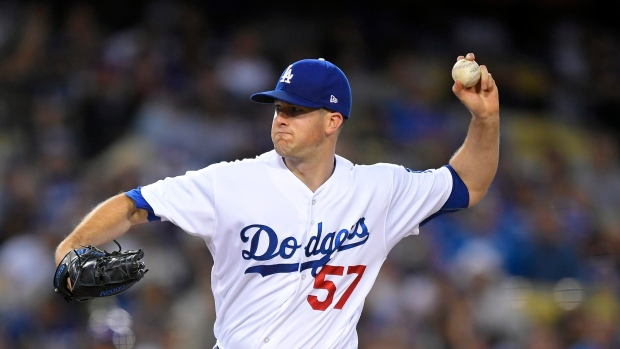 Wood stays undefeated as Dodgers blank Cubs 4-0