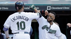 Edwin Encarnacion and Carlos Santana celebrate