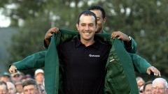 Mike Weir gets his green jacket from Tiger Woods