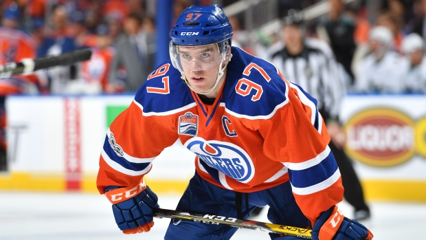 Oilers extend McDavid on massive eight-year, $100M ...