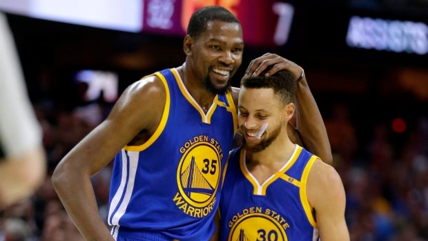 Kevin Durant hugs Steph Curry