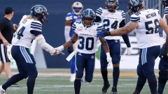 Martese Jackson and Argos celebrate