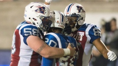 Tyrell Sutton and Alouettes celebrate