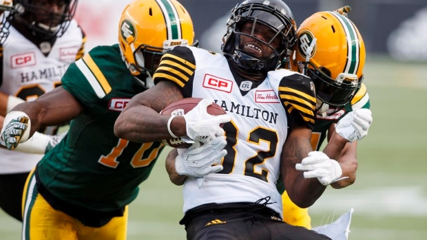 Reilly-leads-eskimos-to-33-28-victory-over-tiger-cats-edmonton-improves-to-6-0-article-image-0