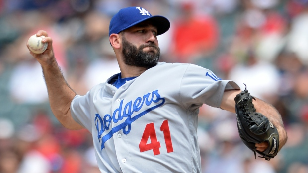 Dodgers trade Chris Hatcher to A's, reinstate Rob Segedin