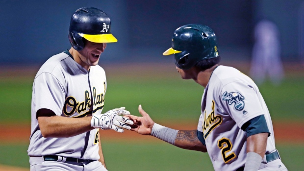 Matt Olson and Khris Davis celebrate