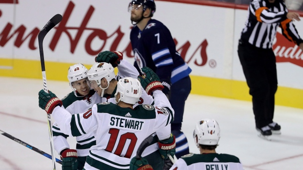Minnesota-wild-players-celebrate