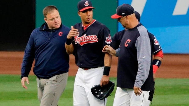 Michael-brantley-with-terry-francona-and-trainer