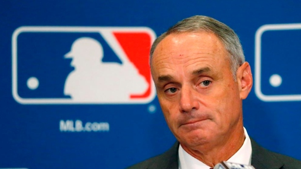 Major League Baseball  extends Manfred through 2024