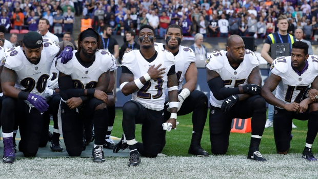 Ravens players kneel during national anthem in London