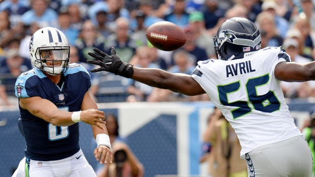 Marcus Mariota and Cliff Avril
