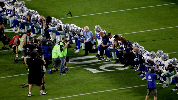 Jerry Jones and Dallas Cowboys kneel before anthem