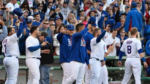 Cubs waive to fans