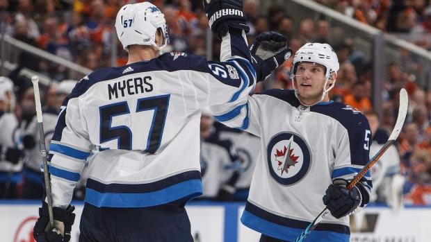 Tyler-myers-and-dmitry-kulikov-celebrate-goal