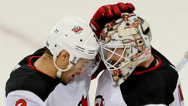 John Moore celebrates with Keith Kinkaid