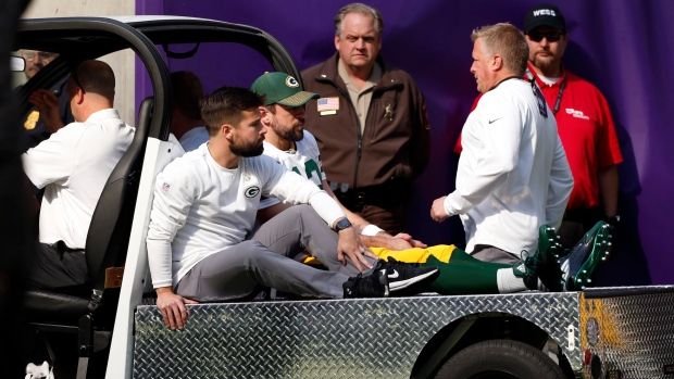 Aaron-rodgers-getting-carted-off-the-field