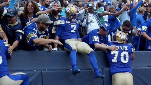 Weston Dressler celebrates with Blue Bombers fans