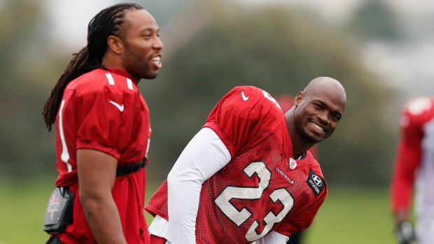 Larry Fitzgerald and Adrian Peterson