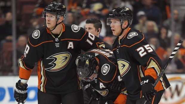 Cam-fowler-helped-off-ice