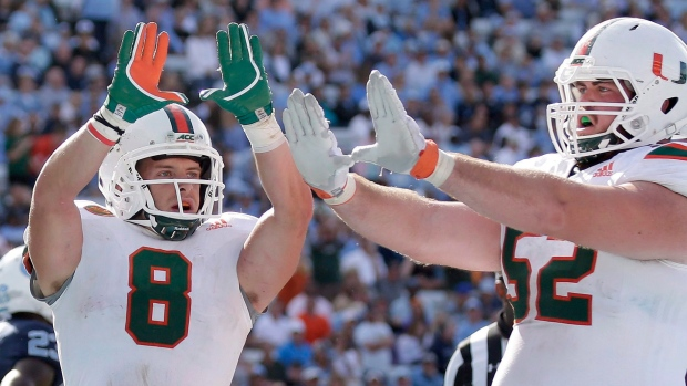 Braxton Berrios (8) and KC McDermott (52)