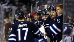 Adam Lowry and Jets Celebrate
