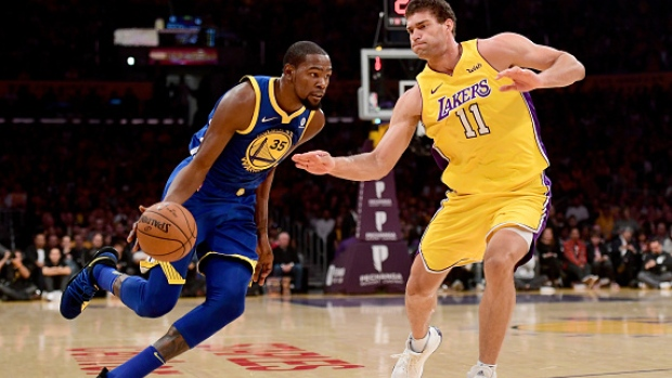 Brook Lopez guards Kevin Durant