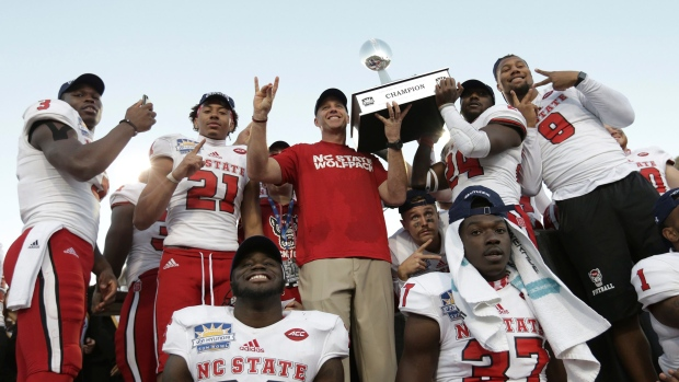 North Carolina State celebrates with the Hyundai Sun Bowl