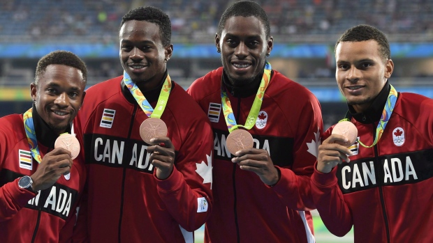 Akeem Haynes (left) with Aaron Brown, Brendon Rodney, and Andre De Grasse