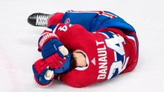 Canadiens say Danault has concussion symptoms after being struck in head Article Image 0