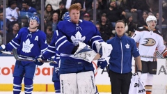 Frederik Andersen with trainer leaving the ice